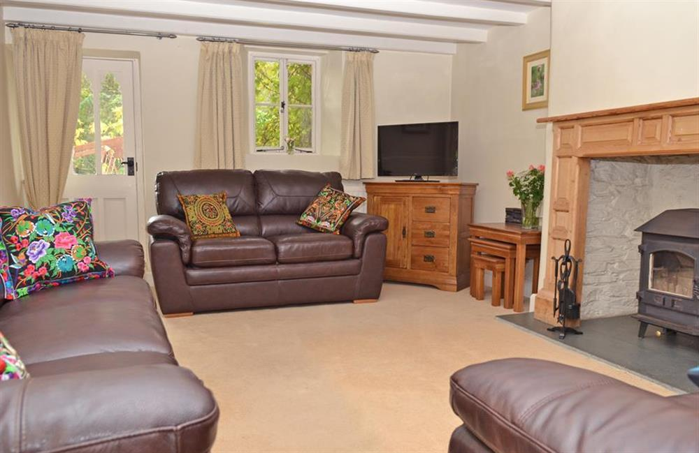 The double aspect lounge with log burner at Rill House, Slapton