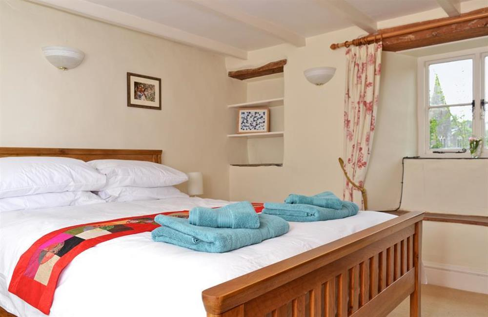 The first floor double bedroom with king size bed at Rill House, Slapton