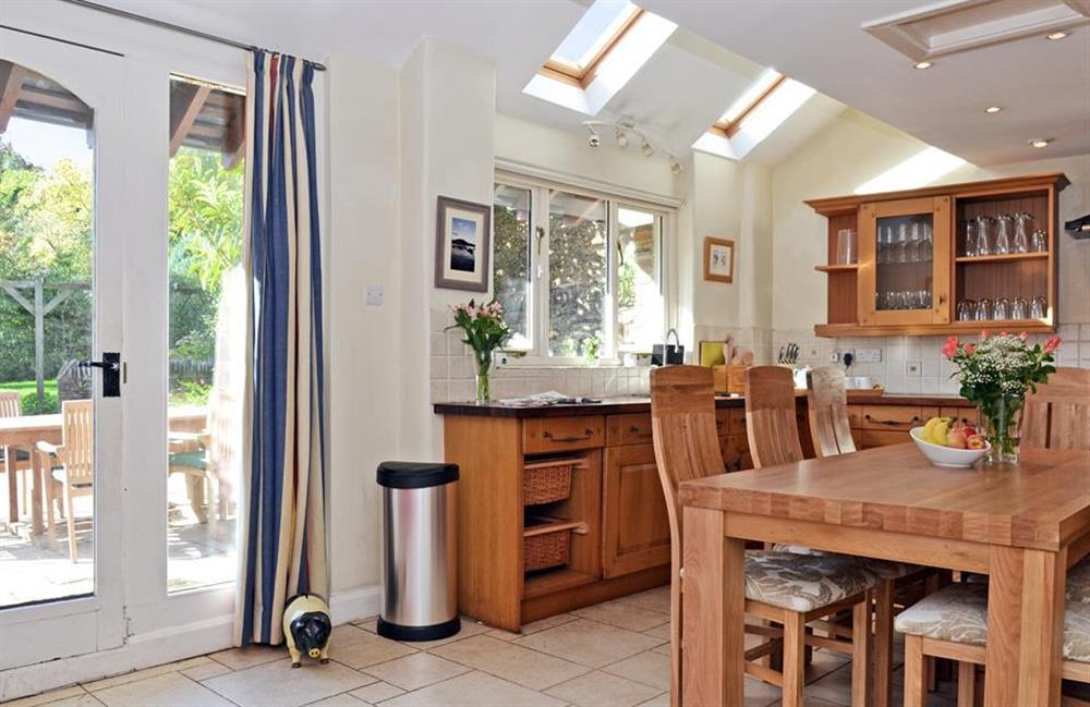The kitchen showing french doors to courtyard at Rill House, Slapton