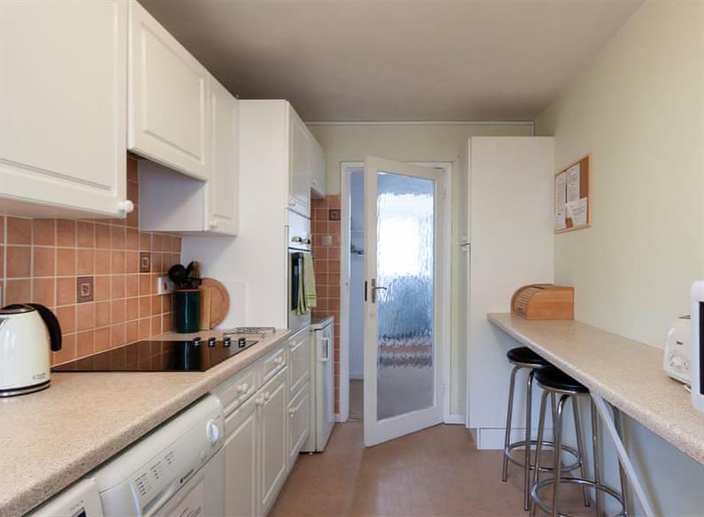 Delightful galley-style kitchen at Rivers Reach in Dartmouth, Devon