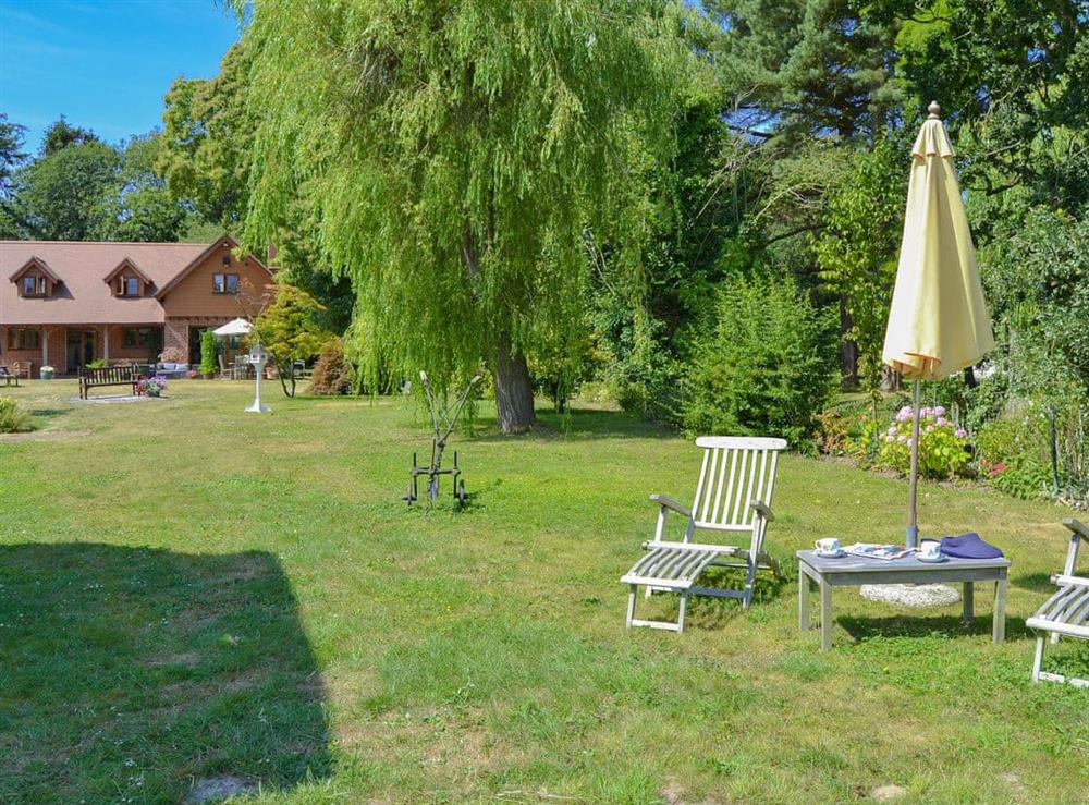 Large lawned garden leading to the riverside at Riversdale Cottage in Irstead, near Wroxham, Norfolk