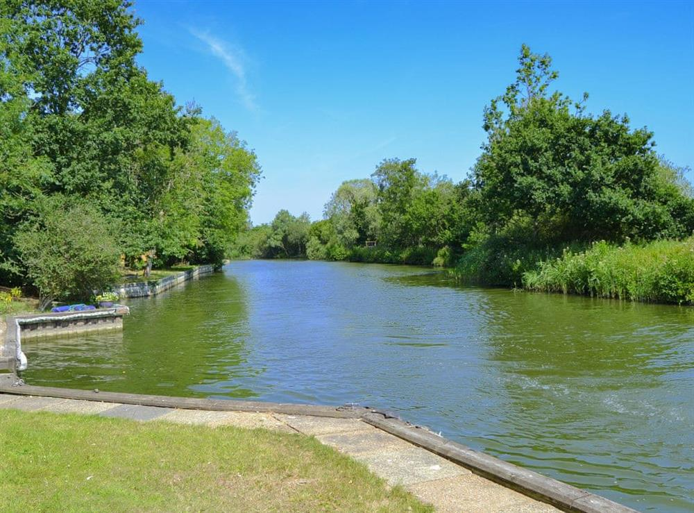Riverside is at the foot of the garden at Riversdale Cottage in Irstead, near Wroxham, Norfolk