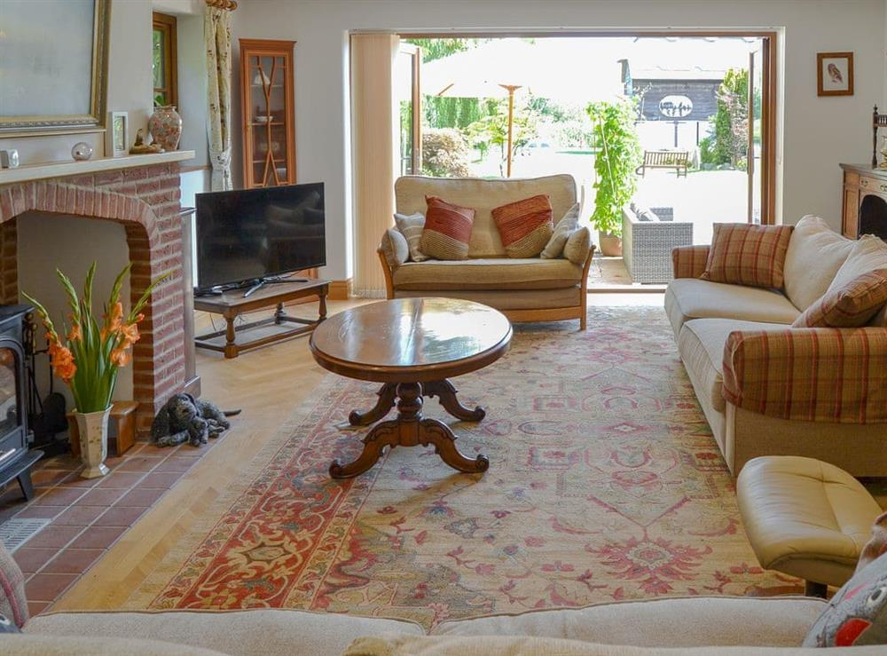 Spacious and comfortable living room at Riversdale Cottage in Irstead, near Wroxham, Norfolk