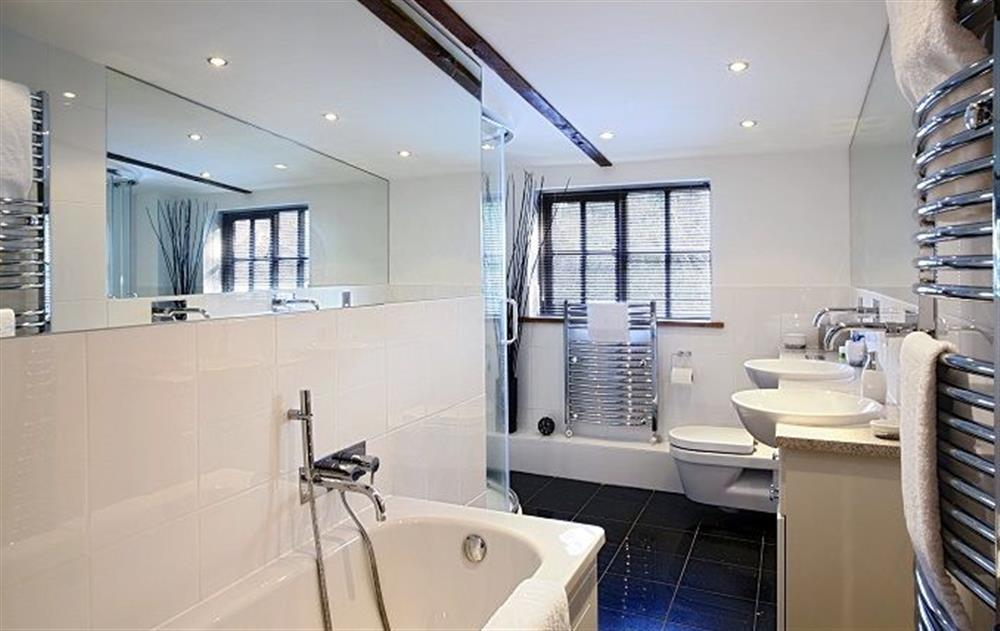 First floor:  Family bathroom with bath, twin basins and separate shower at Riverside Cottage (Suffolk), Old Water Mill