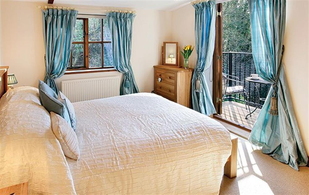 First floor:  Master bedroom with 5' bed and balcony at Riverside Cottage (Suffolk), Old Water Mill