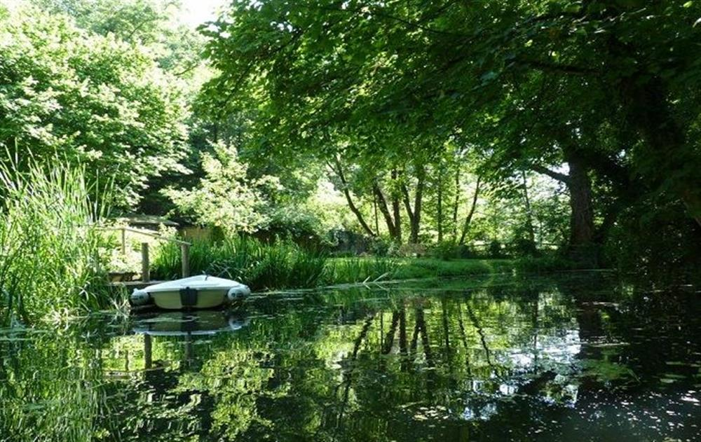 Four person rowing boat and four bikes available  at Riverside Cottage (Suffolk), Old Water Mill