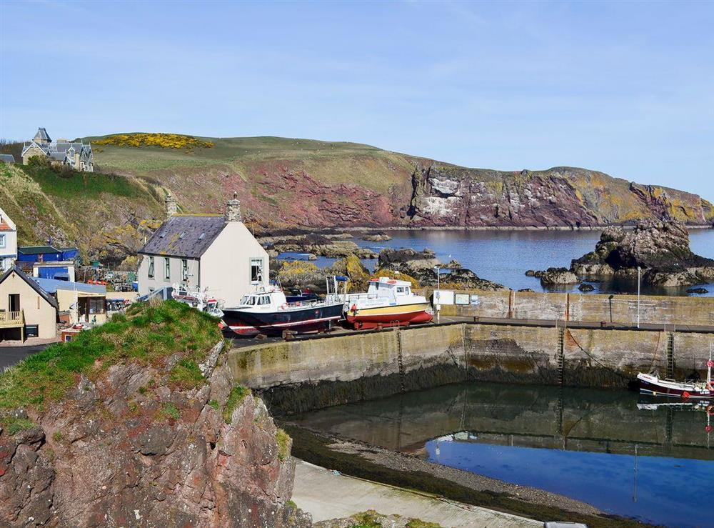 The property is set on the edge of the pretty harbour of St Abbs at Rock Cottage in St Abbs, near Eyemouth, The Scottish Borders, Berwickshire