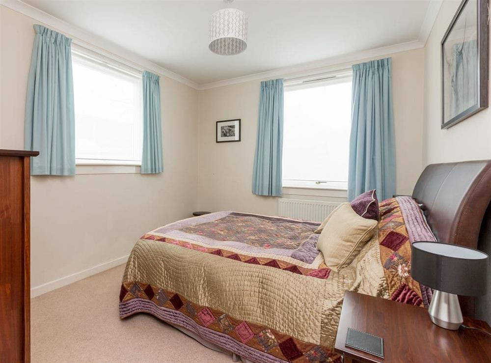 Double bedroom with kingsize bed at Rockcliffe Cottage in South Queensferry, near Edinburgh, West Lothian