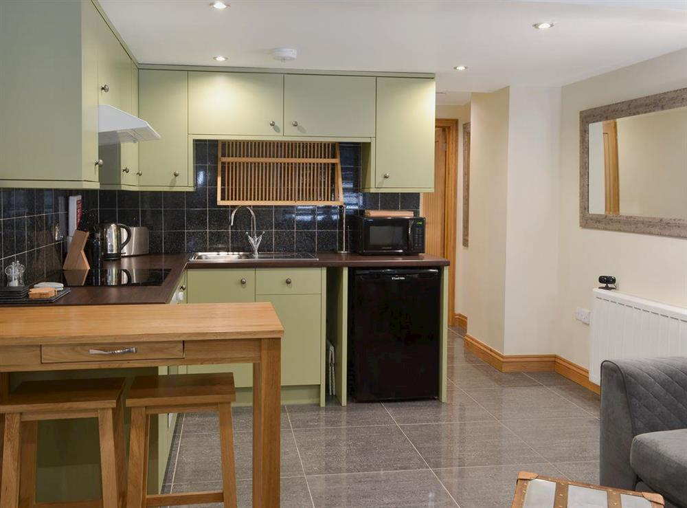 Open plan living/dining room/kitchen (photo 2) at Rockfish Cottage in Brixham, Devon