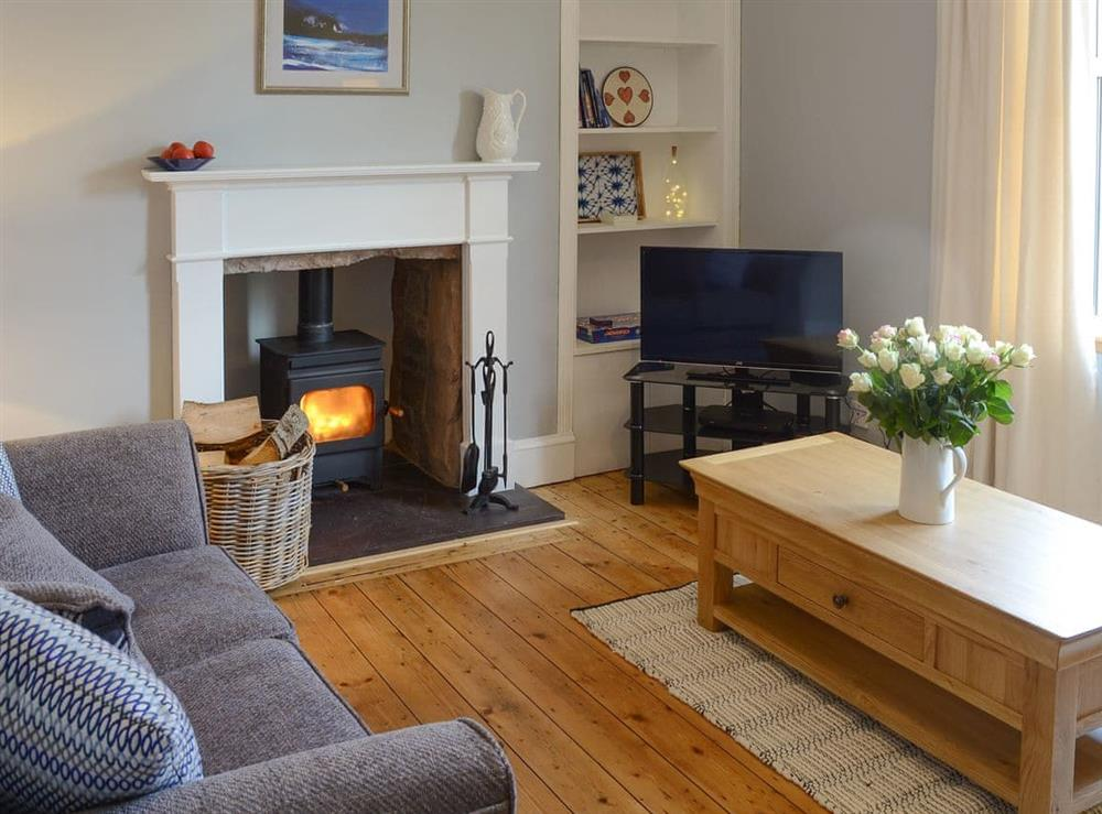Comfortable living room with a cosy wood burner at Rockhill in Inverness, Highlands, Inverness-Shire