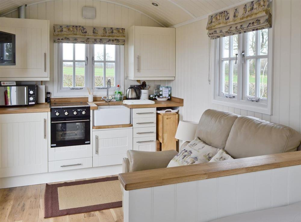 Cosy living area with well-equipped kitchen at The Rookery Shepherds Hut,