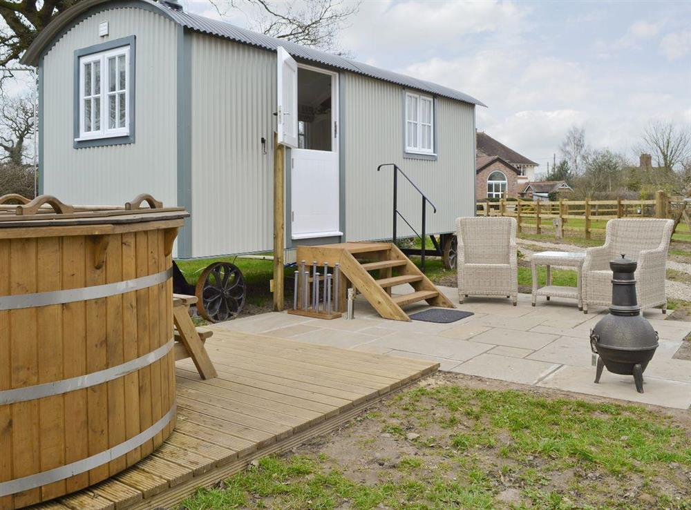 Quirky holiday home with hot tub and patio furniture at The Rookery Shepherds Hut,