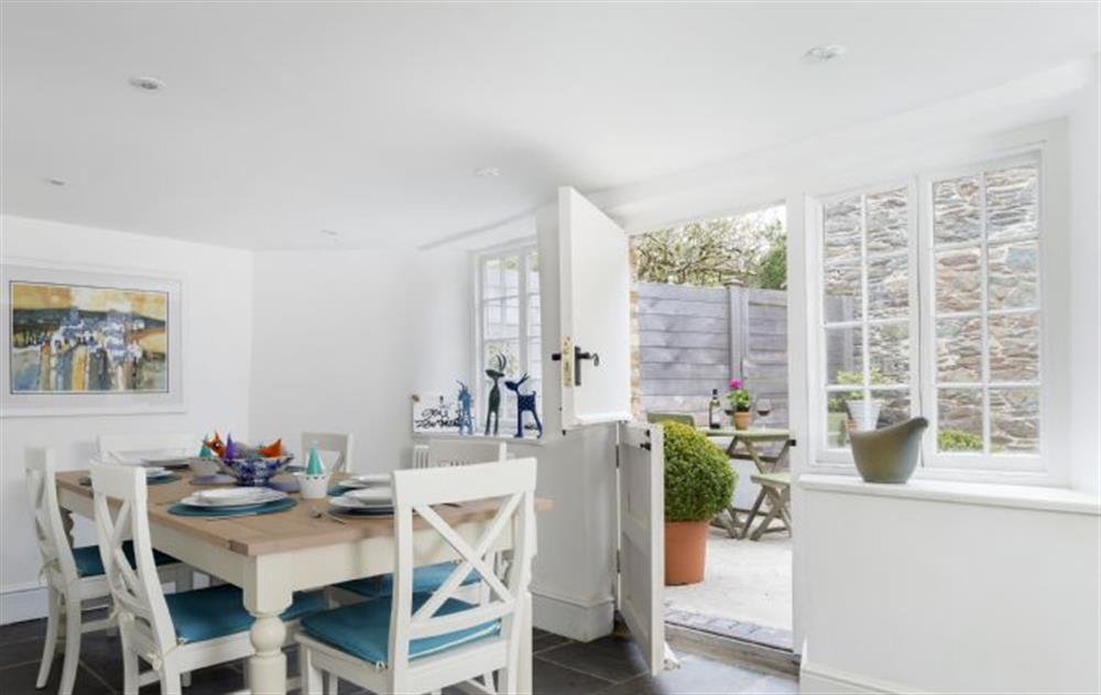Ground floor: Dining area leading to pretty rear patio terrace at Rose Cottage, Ashprington