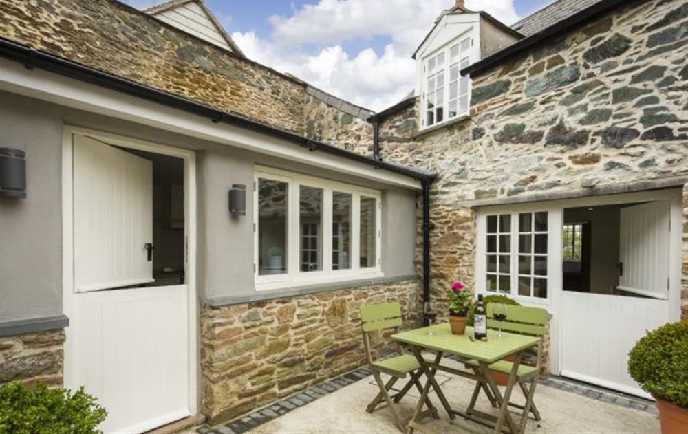 Rear patio, sun trap  at Rose Cottage, Ashprington