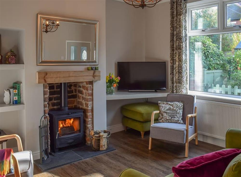 Cosy living room with wood burner at Rose Garden Cottage in Guisborough, Cleveland