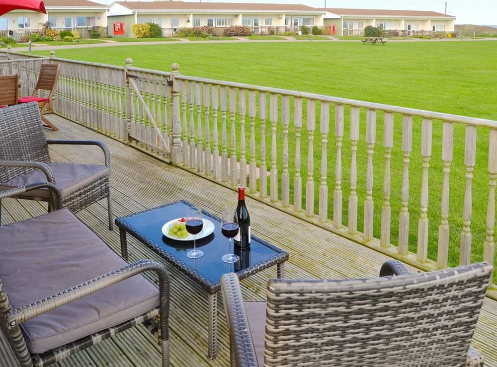 Peaceful decking area at Roses Place in Bacton, Norfolk
