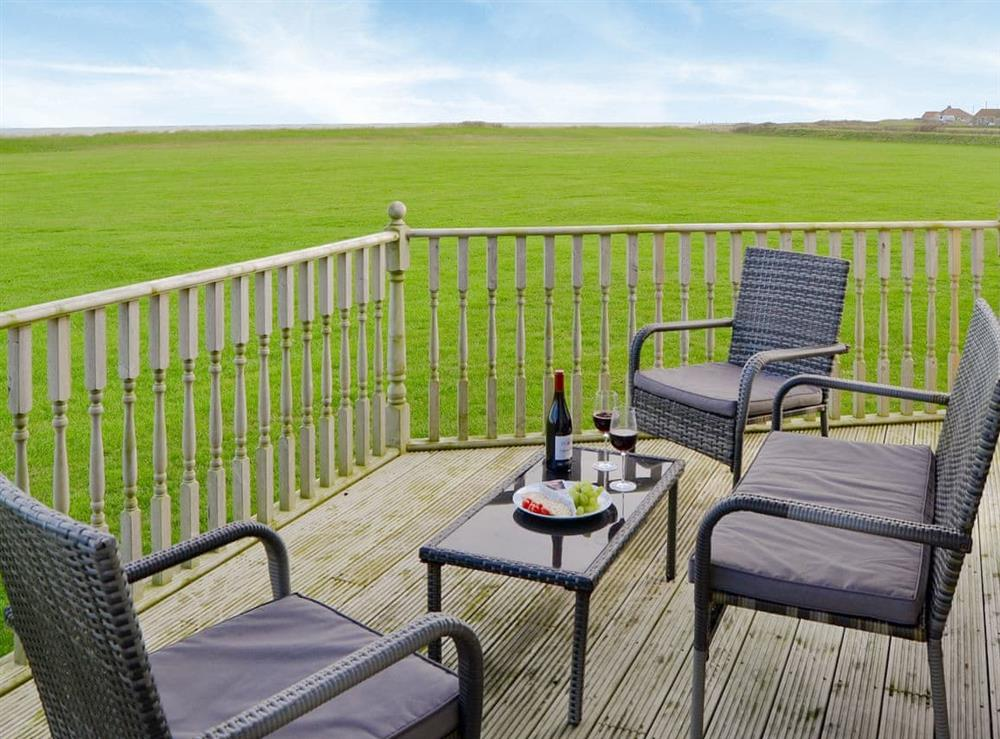 Relaxing decking area with sea views at Roses Place in Bacton, Norfolk