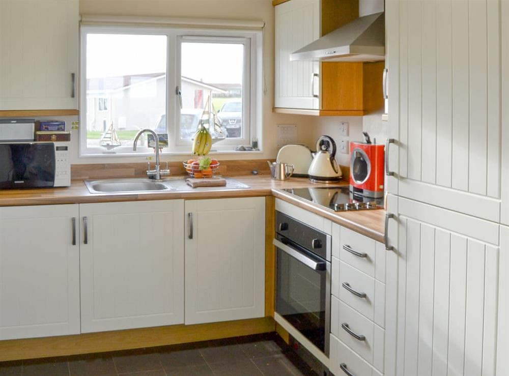 Well equipped kitchen area at Roses Place in Bacton, Norfolk