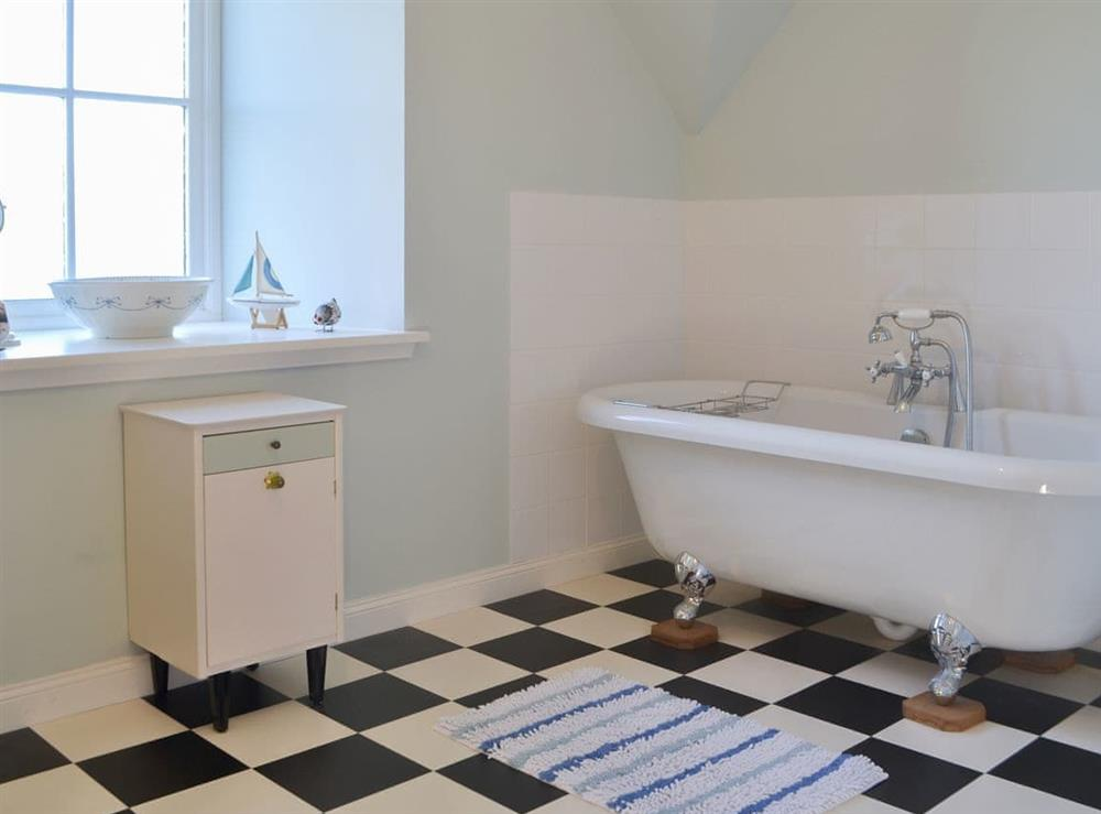 Charming bathroom with telephone style shower attachment at Rowan House in Ardgay, near Dornoch, Ross-Shire