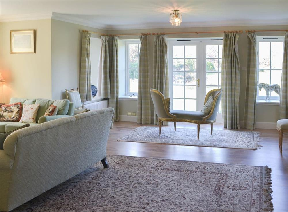 Spacious light and airy living room with French doors to the garden at Rowan House in Ardgay, near Dornoch, Ross-Shire
