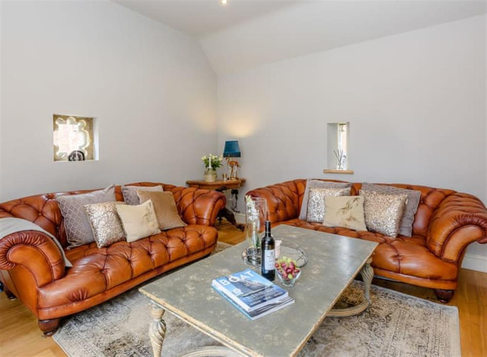 Comfortable seating within living area at Deer View Cottage,