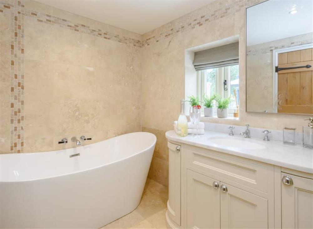 Family bathroom with bath and separate shower cubicle at Deer View Cottage,