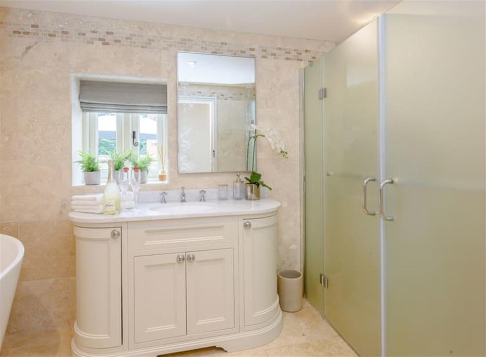 Family bathroom with bath and separate shower enclosure at Deer View Cottage,