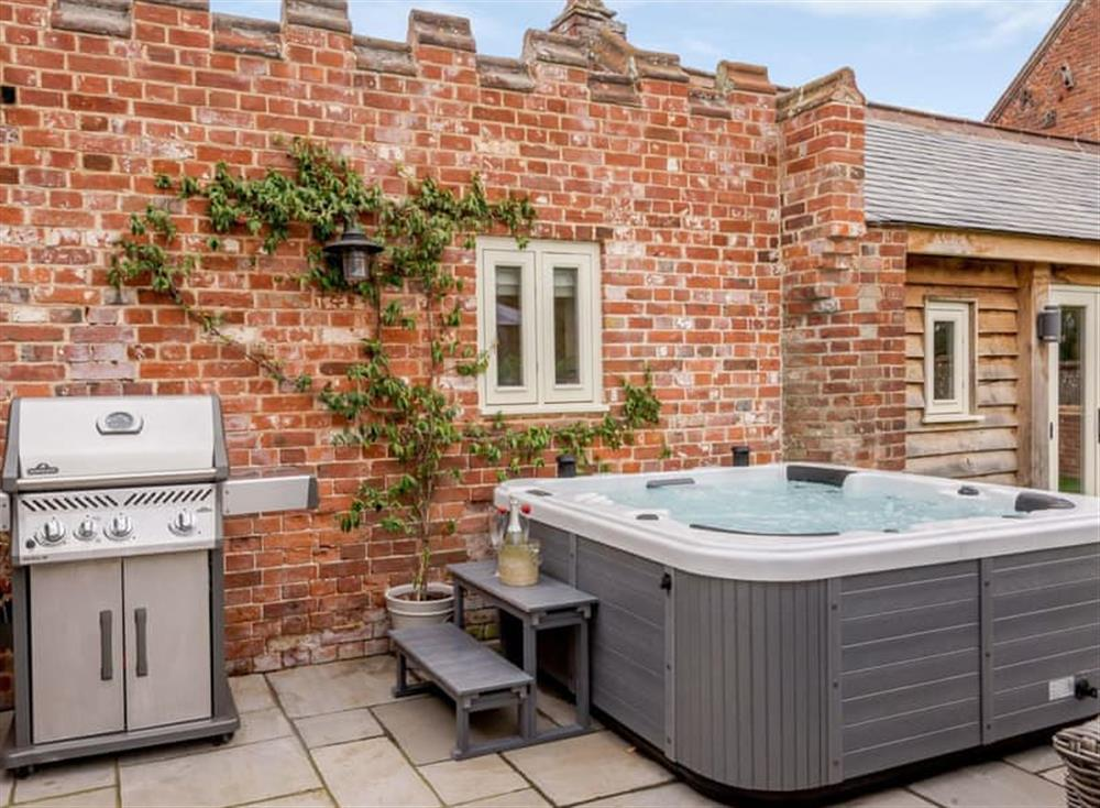 Patio area with hot tub and BBQ at Deer View Cottage,