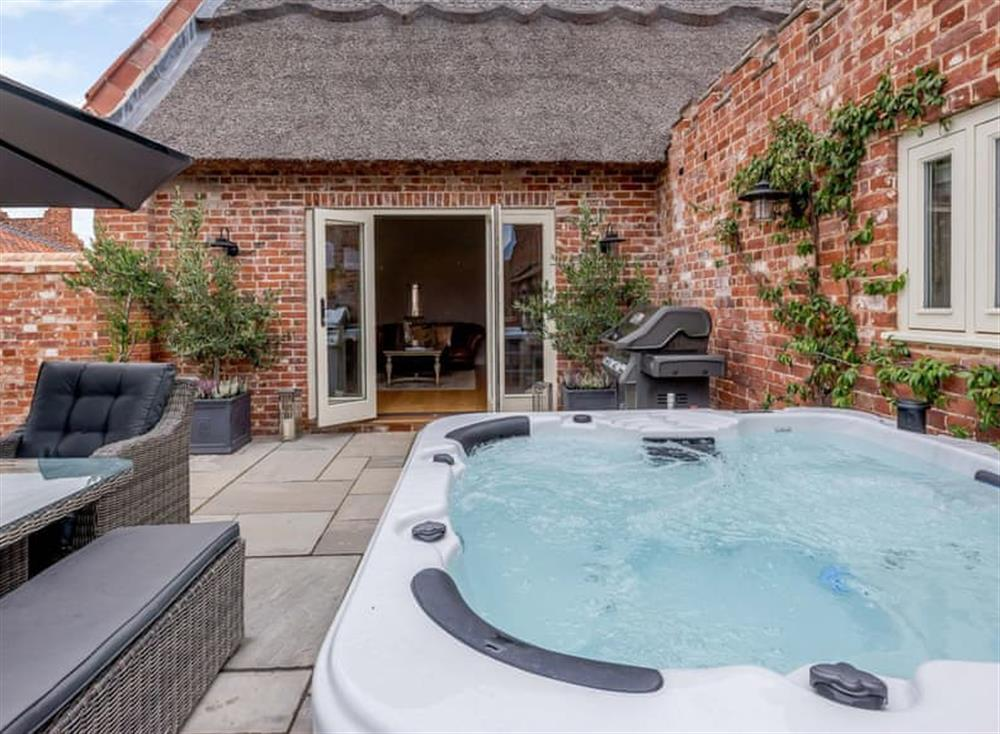 Relaxing hot tub on the patio at Deer View Cottage,