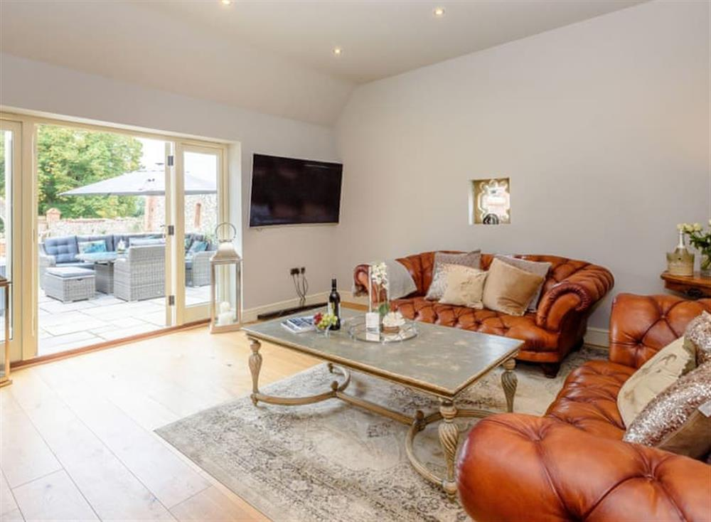 Spacious Living area with French doors to patio at Deer View Cottage,
