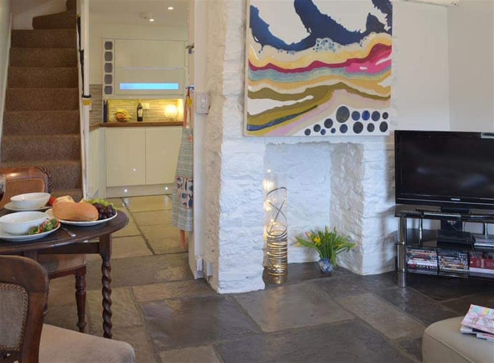 Living room and dining area at Samphire Cottage in Brixham, Devon