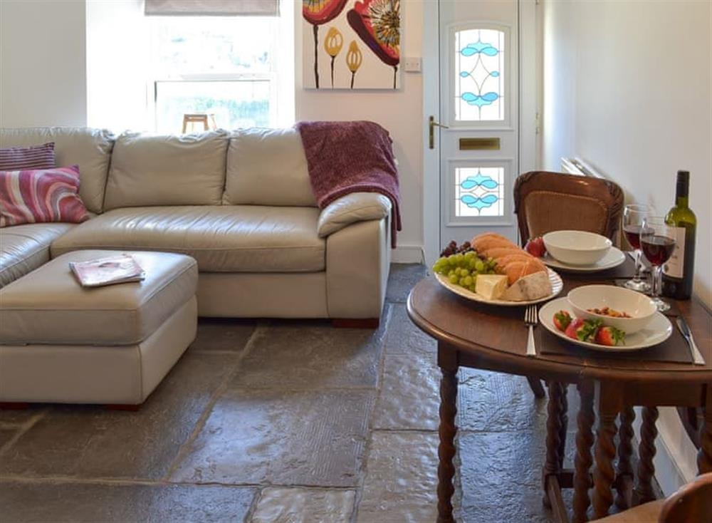 Living room with dining area at Samphire Cottage in Brixham, Devon