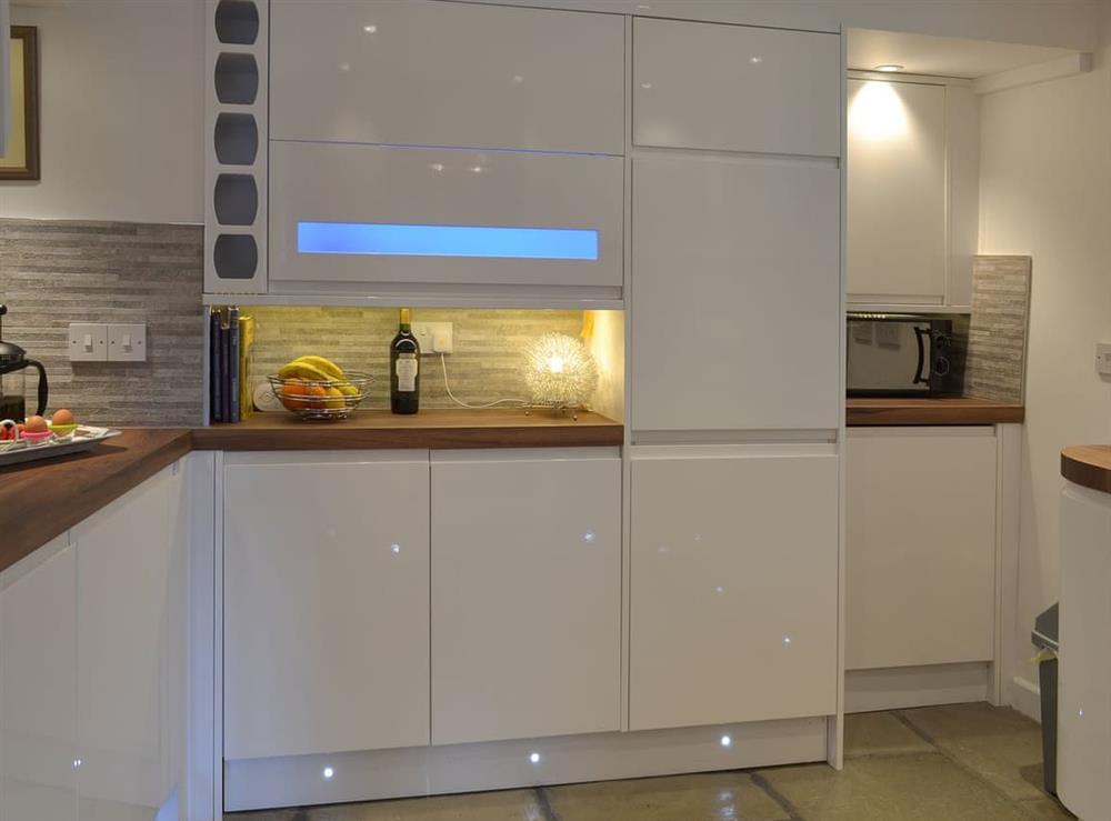 Modern, well equipped kitchen (photo 3) at Samphire Cottage in Brixham, Devon