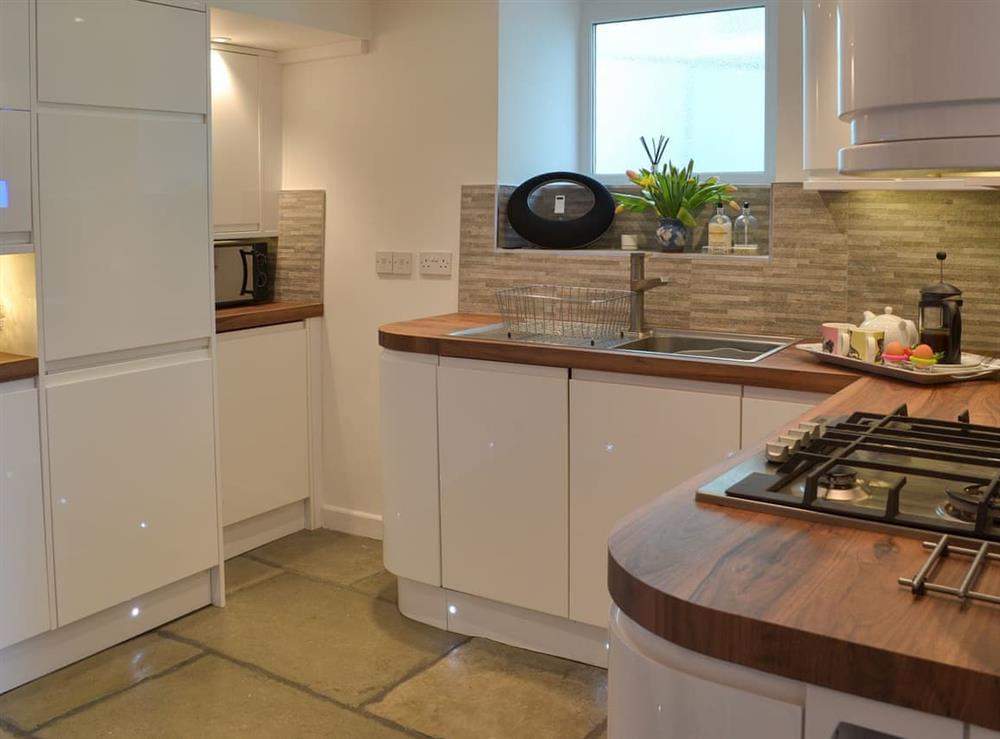 Modern, well equipped kitchen at Samphire Cottage in Brixham, Devon