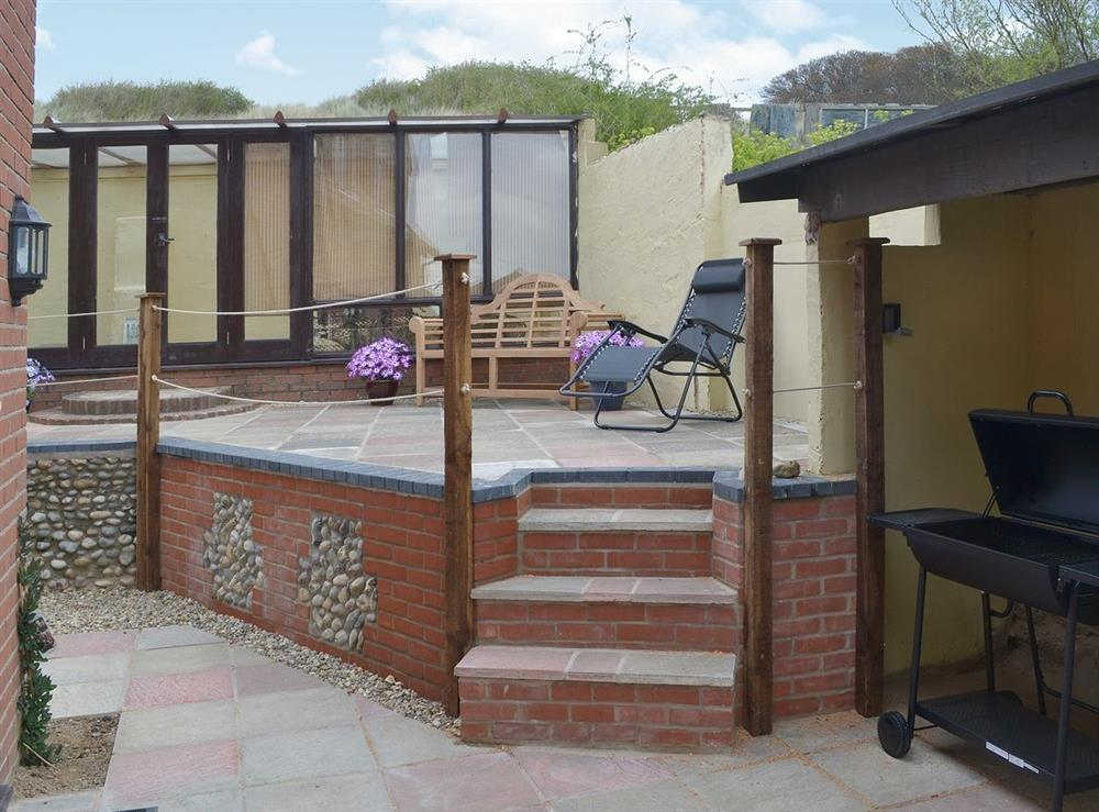 Sitting-out-area at Sand Dune Cottage in Sea Palling, Norfolk