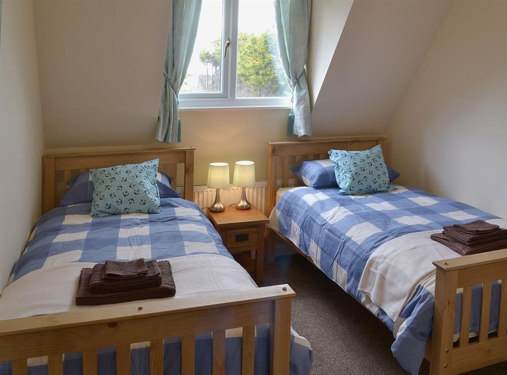 Twin bedroom at Sand Dune Cottage in Sea Palling, Norfolk