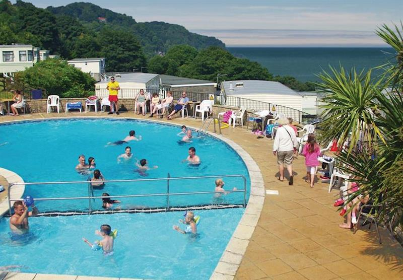 Outdoor heated swimming pool at Sandaway Beach Holiday Park in , Devon