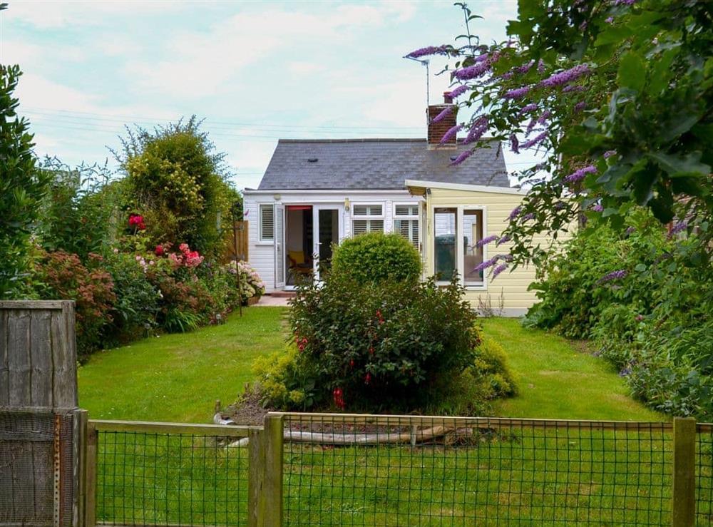 Enclosed lawned garden (photo 2) at Sandhills in Sea Palling, Norfolk