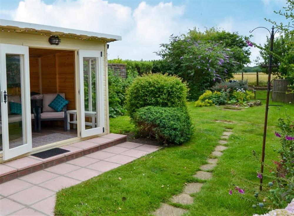 Enclosed lawned garden with patio, summerhouse and garden furniture (photo 2) at Sandhills in Sea Palling, Norfolk