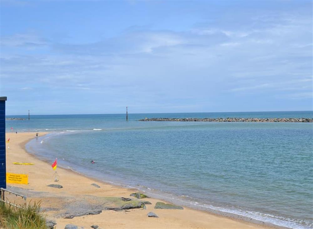 Within easy reach of the beach at Sea Palling at Sandhills in Sea Palling, Norfolk