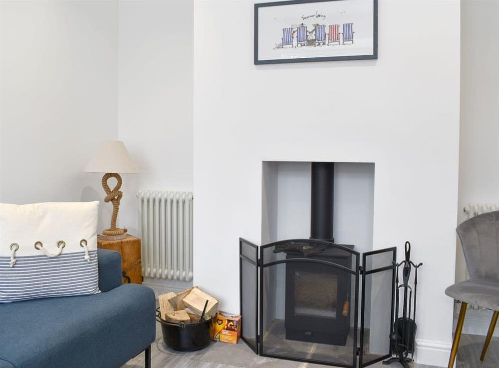 Delightful living room with wood burner at Sapphire Cottage in Lowestoft, Suffolk