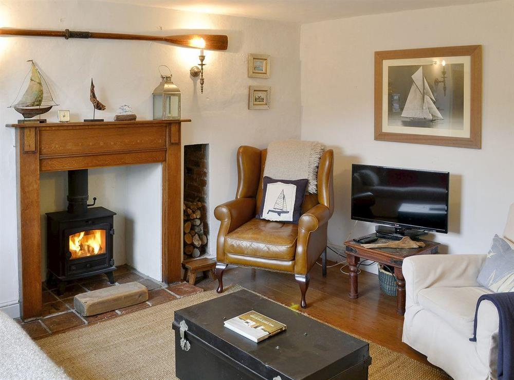 Cosy living room with woodburner at Sea Breeze in Blakeney, Norfolk
