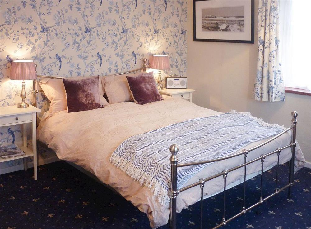 Cosy and romantic master bedroom with kingsize bed at Sea La Vie in Mundesley, near North Walsham, Norfolk