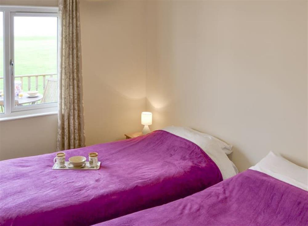 Comfortable twin bedroom at Sea Space in Bacton, Norfolk