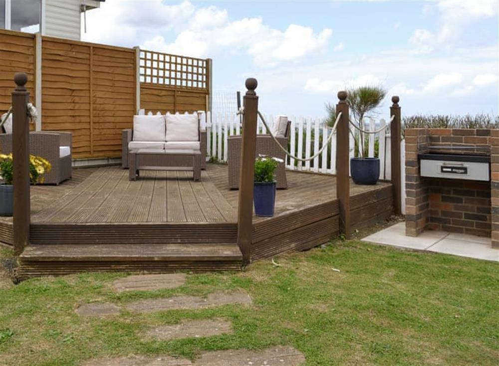 Raised decking within the garden at Sea View Cottage in East Runton, near Cromer, Norfolk