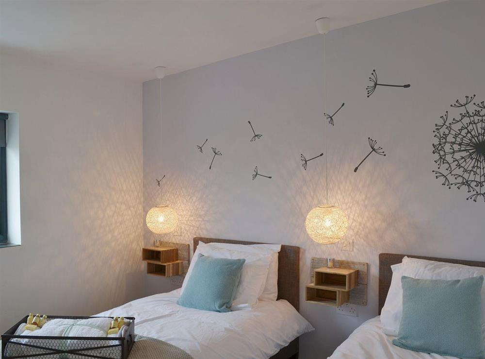 Beautiful contemporary vinyl decals adorn the wall of the twin bedroom at Seaglass Barn in East Ruston, near Stalham, Norfolk
