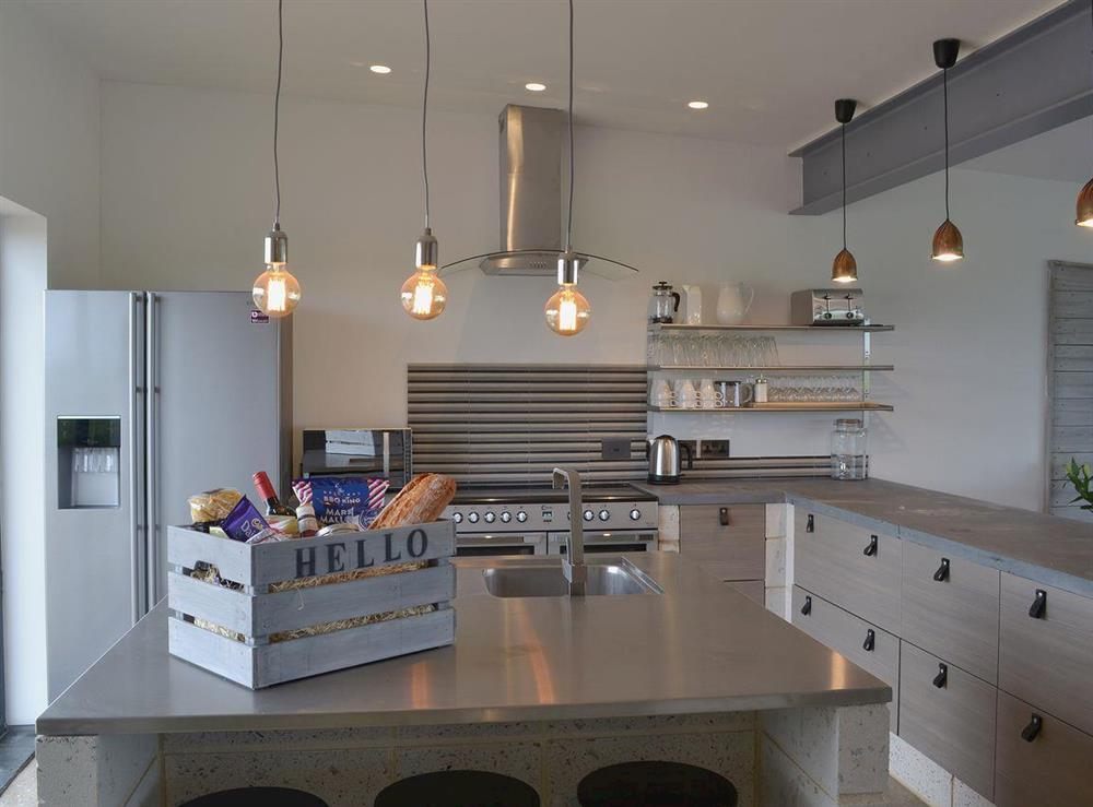 Beautiful kitchen area with island and myriad storage space at Seaglass Barn in East Ruston, near Stalham, Norfolk