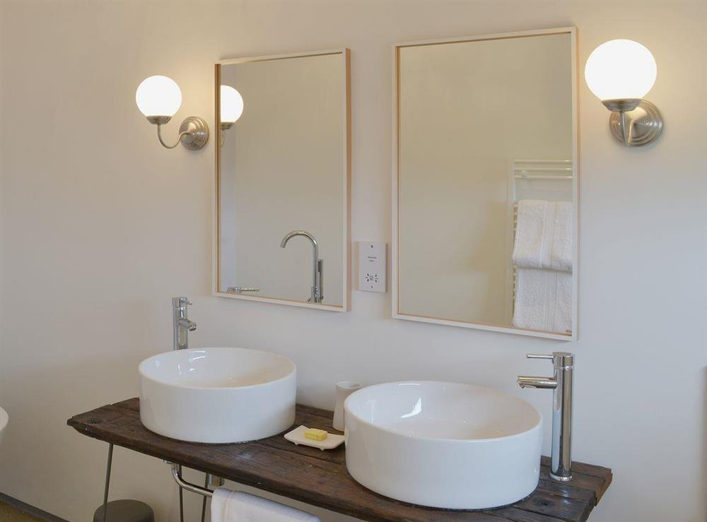 Lovely bathroom with matching wash basins at Seaglass Barn in East Ruston, near Stalham, Norfolk