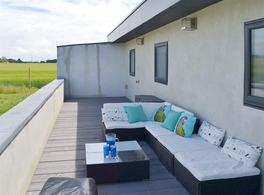 Lovely comfortable terrace furniture for lounging at Seaglass Barn in East Ruston, near Stalham, Norfolk