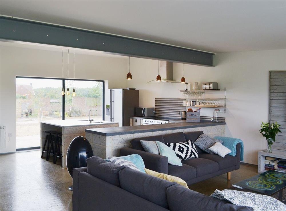 Spacious living area designed in an industrial chic style at Seaglass Barn in East Ruston, near Stalham, Norfolk